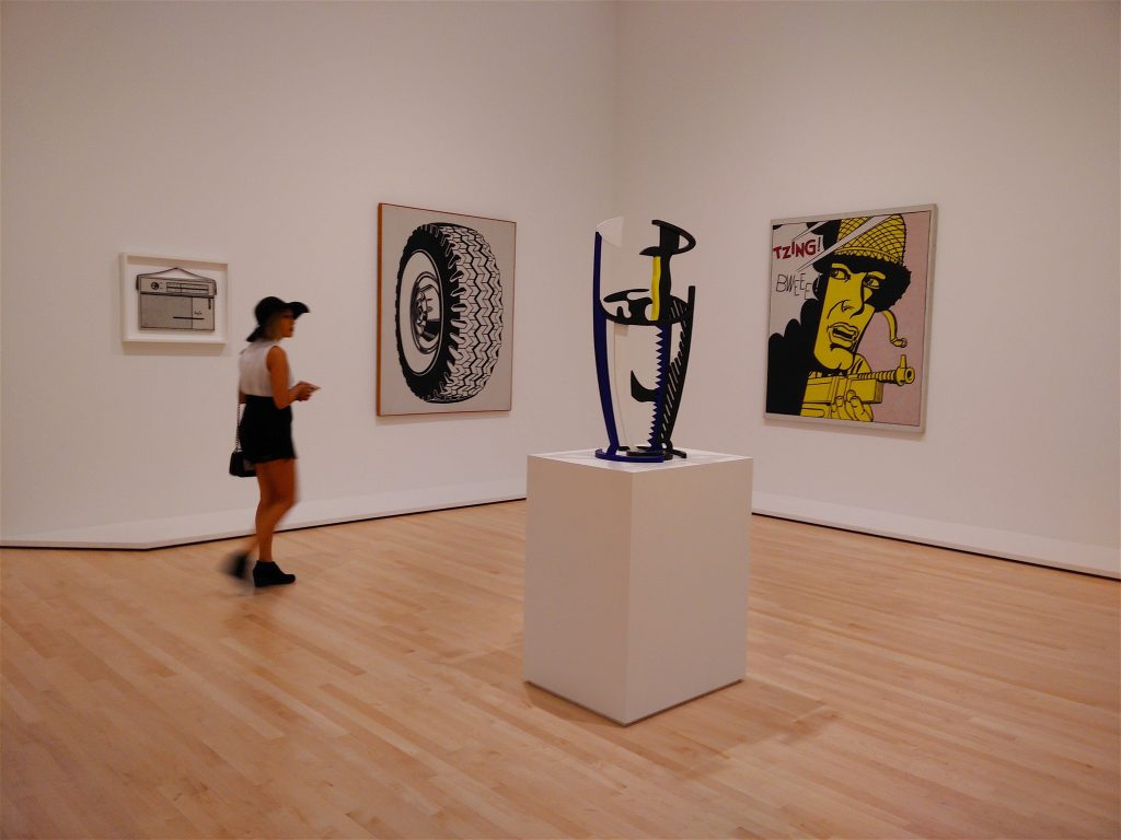 woman in Lichtenstein gallery at SFMOMA, Lichtenstein gallery at SFMOMA, SFMOMA, San Francisco Museum of Modern Art, museums in San Francisco, San Francisco, Roy Lichtenstein, art of Roy Lichtenstein, art, American art, Modern art, pop art, graphic art, woman in hat, woman appreciating art, woman in art gallery, woman in a museum, art appreciation, culture, painting, museums, sculpture, Modernism, American culture, American pop culture, travel